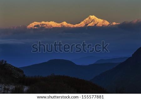 Sunrise on Mount Kanchenjunga, Himalaya mountain range, Lungthang, Sikkim - stock photo