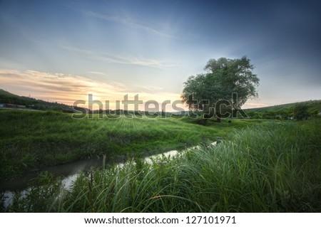 sunrise on river - stock photo