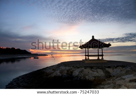 Sunrise on Sanur beach - stock photo