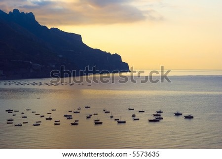 Sunrise on sea and on small harbor - stock photo