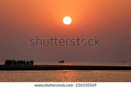 Sunrise on seashore at Kuakata, Bangladesh - stock photo