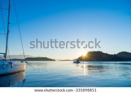 Sunrise on the bay of Nidri in Lefkas island Greece - stock photo
