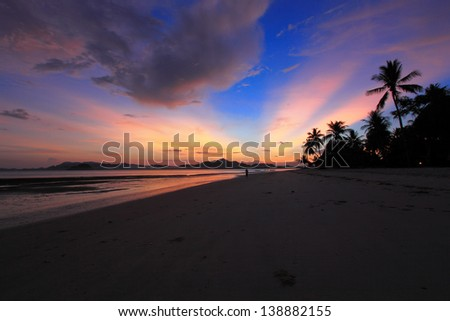 Sunrise on the beach - stock photo
