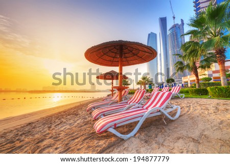 Sunrise on the beach at Perian Gulf in Abu Dhabi - stock photo