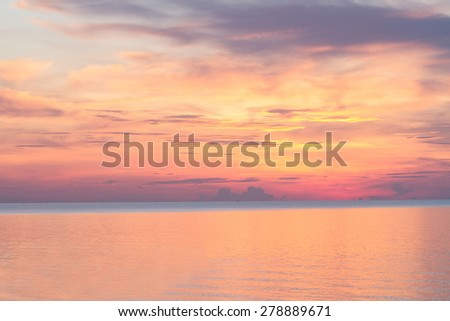 Sunrise on the beach in the morning and beautiful sky - stock photo