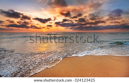 Sunrise on the beach of caribbean sea. - stock photo