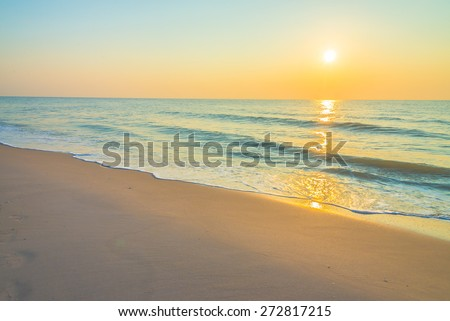 Sunrise on the beach - vintage filter - stock photo