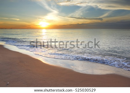 Sunrise on the beach with beautiful blue sky