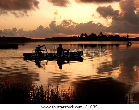 Sunrise on the lake in Belize - stock photo