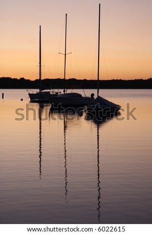 sunrise on the lake, reflections of the yachts