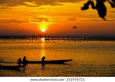 Sunrise on the lake with beautiful sky - stock photo