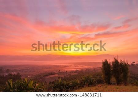 Sunrise on the mountain. - stock photo