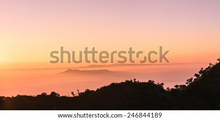 Sunrise on the mountain panorama - stock photo