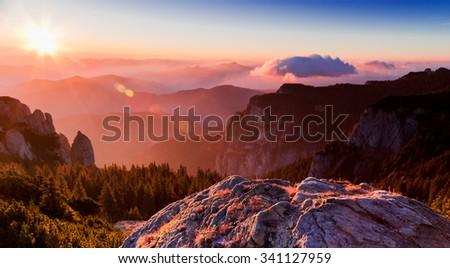 Sunrise on the mountain peak Ceahlau - stock photo