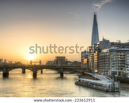 Sunrise on the new London skyline with Tower Bridge and the new The Shard skyscraper.