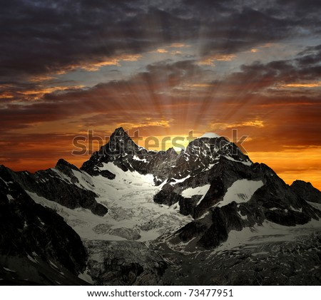 sunrise on the Ober Gabelhorn - Swiss Alps - stock photo