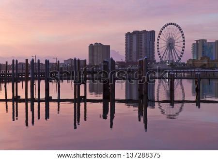 Sunrise on the Pensacola Beach ferris wheel on Santa Rosa Sound in Pensacola Beach, Florida - stock photo