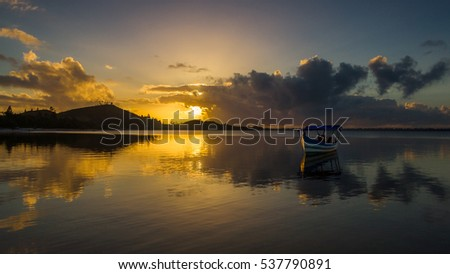 Sunrise on the Rasoabe lake, of the Pangalanes Channel, East of Madagascar