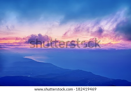 Sunrise on the sea, natural travel autumn landscape with dramatic sky and clouds - stock photo