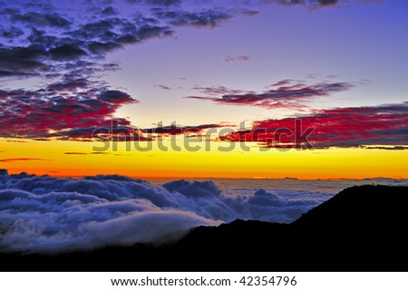 Sunrise on the summit of Haleakala on the Hawaiian Island of Maui - stock photo
