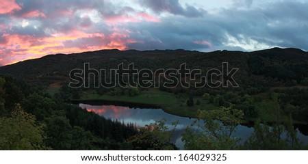 Sunrise on the Tummel loch around Pitlochry, Scotland, UK - stock photo