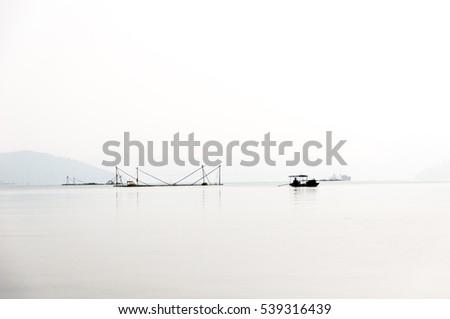 sunrise on thung nai lake , hoa binh , viet nam