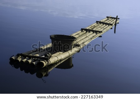Sunrise over a bamboo fishing raft on a lake, Philippines - stock photo