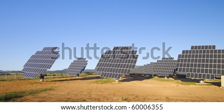 sunrise over a field of solar electric production