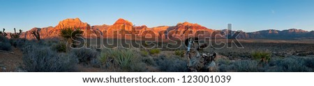 Sunrise over a mountain range in Red Rock State Park near Las Vegas, Nevada. - stock photo