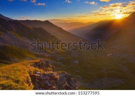 sunrise over a mountain valley - stock photo