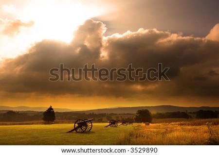 Sunrise over a row of cannon at the Antietam Civil War Battlefield at Sharpsburg, Maryland USA - stock photo