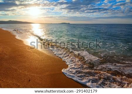 sunrise over a sea beach - stock photo