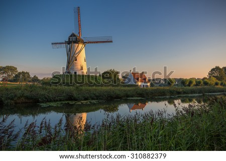 Sunrise over a windmill in Damme, Belgium - stock photo