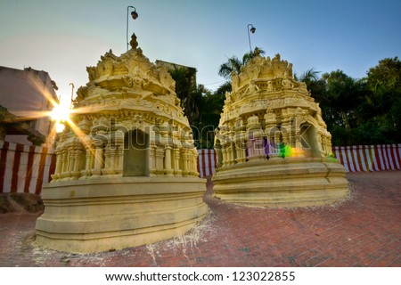 Sunrise over an Indian Hindu temple - stock photo