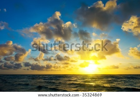 Sunrise over Atlantic ocean coast, FL, USA - stock photo