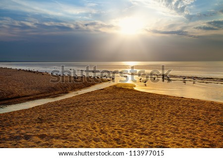 Sunrise over beautiful beach - stock photo