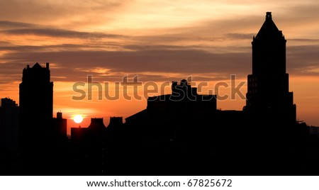 Sunrise over Brooklyn with silhouette of buildings. - stock photo