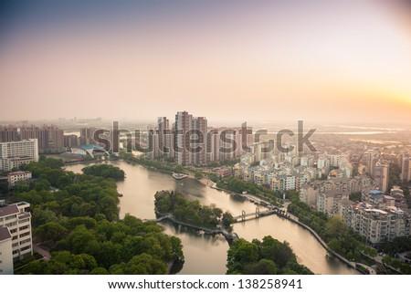 sunrise over city of Fuzhou Jiangxi Province, China - stock photo