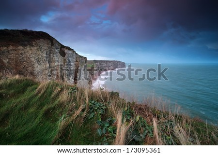 sunrise over cliff in ocean, Etretat, Normandy, France