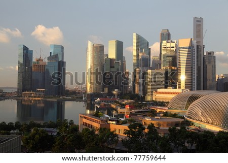 Sunrise over Downtown Skyline Singapore. Many skyscrappers at business district are in view