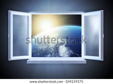Sunrise over Earth seen from a partially opened window - stock photo