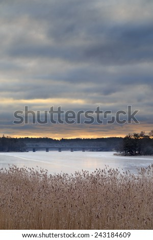 Sunrise over frozen lake Magelugnen in Farsta in Stockholm, Sweden - stock photo