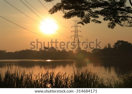 Sunrise over lake and reflect together with clouds and sky