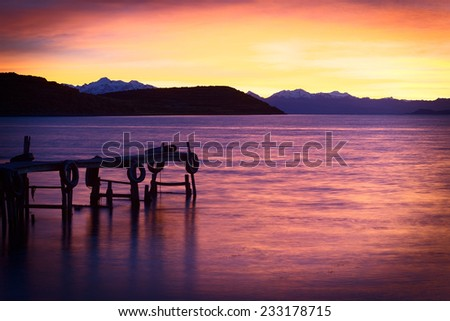 Sunrise over Lake Titicaca in the bay of Cha'lla with the snow-capped mountains of the Andes in the back viewed from the small village of Cha'llapampa on Isla del Sol (Island of the Sun) in Bolivia - stock photo