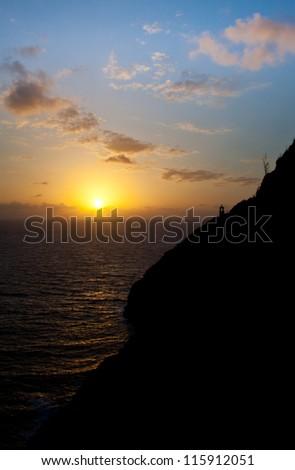 Sunrise over Makapu'u point and lighthouse on the coast of Oahu. - stock photo