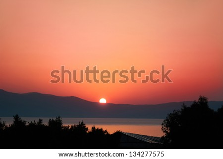 Sunrise over Mediterranean sea on island of Crete, Greece - stock photo