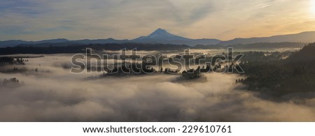 Sunrise over Mount Hood and Foggy Sandy River in Scenic Oregon Panorama - stock photo