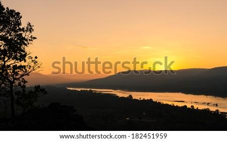 Sunrise over mountain in Ubon Ratchathani, Thailand - stock photo