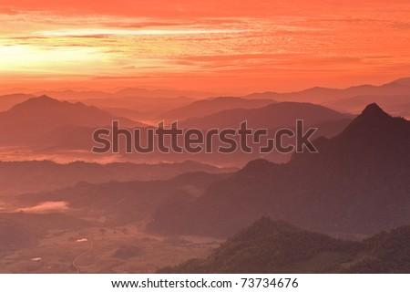 Sunrise over mountain, Phu Cheefa national park, Thailand. - stock photo