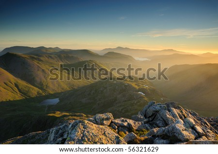 Sunrise over mountains in the English Lake District - stock photo